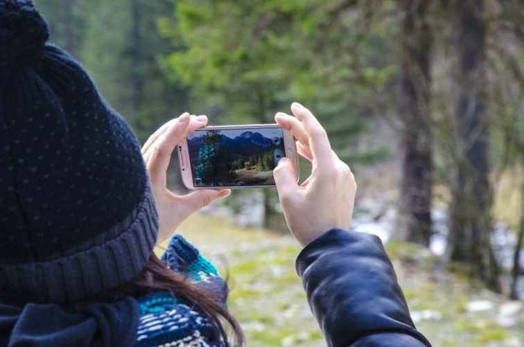 woman-taking-photo-of-forest