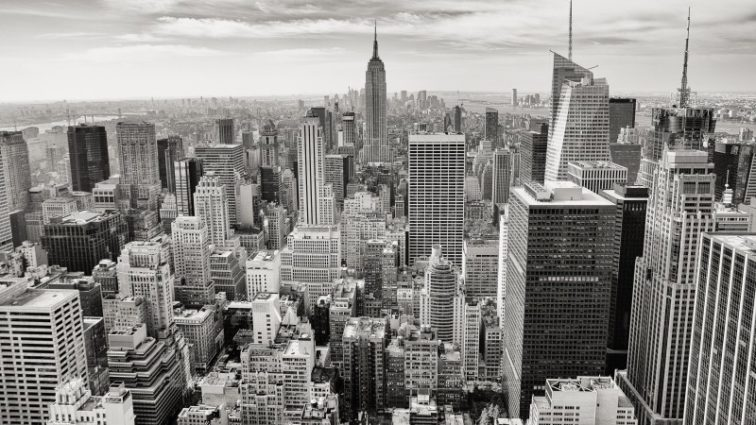 black-and-white-image-of-city-skyline-and-clouds